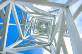 Close up on white steel tower, up view from the center. — Stock Photo