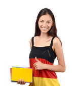 Thumbs up. Beautiful student with Germany flag blouse holding books. — Stock Photo