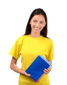 Beautiful student in yellow blouse holding books. — Stock Photo