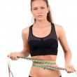 Beautiful fit girl measuring her waist with three measuring tapes. — Stock Photo