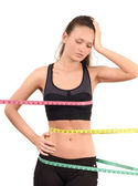 Measuring bust, waist, hips. Beautiful fit girl wrapped with three measuring tapes in inch. — Stock Photo