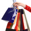 Female hand holding many shopping bags and a credit card. — Stockfoto