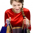 Young woman looking inside the shopping bags. — Stock Photo