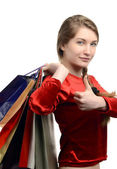 Young woman carrying many shopping bags, thumbs up. — Stock Photo