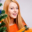 Stock Photo: Beautiful young woman smiling holding Christmas presents.