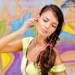 Beautiful young woman with headphones relaxing and listening to music. — Stock Photo