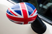 Close up on a side mirror of a car with the UK flag on it. — Stock Photo