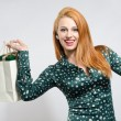 Happy young woman shopping for the holidays. — Stock Photo