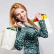 Happy young woman shopping for the holidays. — Stock Photo #35760327