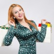Happy young woman shopping for the holidays. — Stock Photo #35760331
