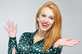 Portrait of a happy young beautiful woman with her hands up. — Stock Photo