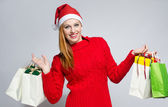 Happy young woman shopping for the Christmas holidays. — Foto Stock