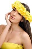 Portrait of a sexy woman with wreath of yellow flowers on the head. — Stock Photo