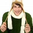 Portrait of a handsome man dressed for a cold winter. Man in sweater with hat and scarf. — Stock Photo