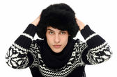 Portrait of a handsome man dressed for a cold winter.Man wearing a cute pullover with snowflakes. — Stock Photo