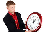 Business time. Business man holding and looking to a big clock. — Stock Photo