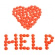 Red heart drugs. Pills arranged in heart shape with help sign. — Stock Photo