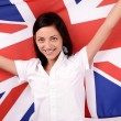 Stock Photo: Portrait of a beautiful British girl smiling holding up the UK flag.