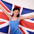 Beautiful British girl smiling holding up the UK flag. — Stock Photo #42155069