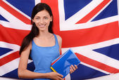 Learn English. Beautiful student holding books, blue blank book cover. — Stock Photo