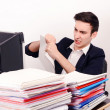 Stock Photo: Angry business mtearing up paper work.