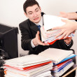 Stock Photo: Desperate business mreceiving lot of paper work.