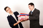 Desperate worker receiving a lot of paper work from his happy boss. — Stock Photo