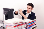 Angry business man tearing up paper work. — Stock Photo