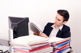 Business man working with a lot of paper work. — Stock Photo