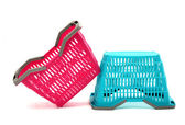 Blue and pink plastic shopping basket isolated on white. — Foto Stock