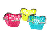 Blue, yellow and pink plastic shopping basket isolated on white. — Stock Photo