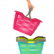 Woman hand taking a shopping basket from a pile. — Stockfoto
