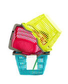 Pile of colorful plastic shopping baskets with blank shopping list. — Foto de Stock