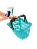 Woman hand holding a market basket with a shopping list and a credit card. — Stock Photo
