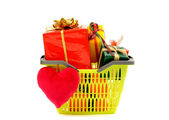 Market basket full of nicely wrapped presents and a red heart. — Stock Photo