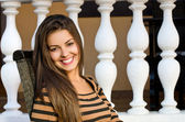 Beautiful girl smiling sitting on a chair. — Stock Photo