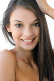 Portrait of a beautiful brunette girl smiling. — Stock Photo