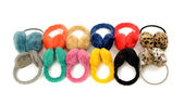 Cute colorful earmuffs arranged in a line. — Stock Photo