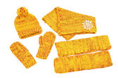 Matching yellow neck wear, a pair of mittens, a hat and leg warmers nicely arranged. — Zdjęcie stockowe