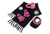 Black wool scarf with  matching pink gloves,a visor hat and earmuffs. — Stock Photo