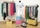 Dressing closet with polka dots clothes arranged on hangers and an outfit on a mannequin. — Stock Photo