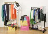 Dressing closet with polka dots clothes arranged on hangers. — Stock Photo
