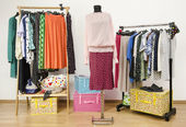 Dressing closet with polka dots clothes arranged on hangers and a pink outfit on a mannequin. — Stock Photo