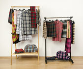 Dressing closet with plaid clothes arranged on hangers on racks. — Stock Photo