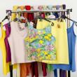 Cute summer tank tops displayed on a rack. — Stock Photo #47172993
