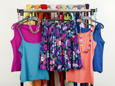 Cute summer outfits displayed on a rack. Floral skirt with matching tank tops. — Stock Photo