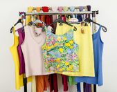 Cute summer tank tops displayed on a rack. — Stock Photo