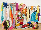 Untidy cluttered woman wardrobe with colorful clothes and accessories. — Stock Photo