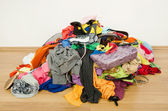 Big pile of clothes and accessories thrown on the ground. — Stock Photo