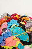 Close up on a big pile of clothes and accessories thrown on the ground. — Stock Photo